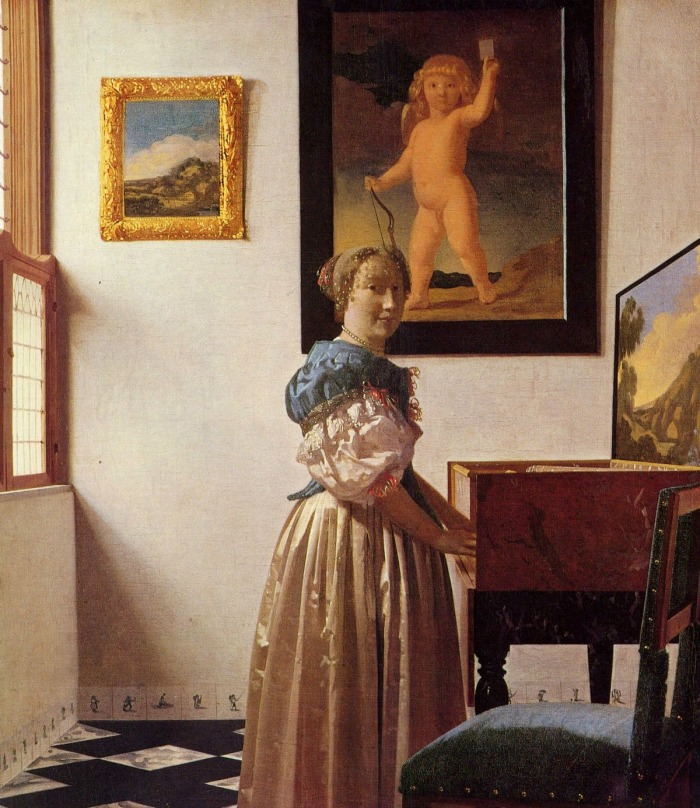 johannes_vermeer_giovane_donna_in_piedi_al_virginale_1670_1673_ca